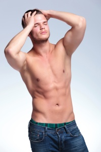 topless young man with closed eyes
